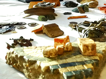assortment of archaeological objects on table