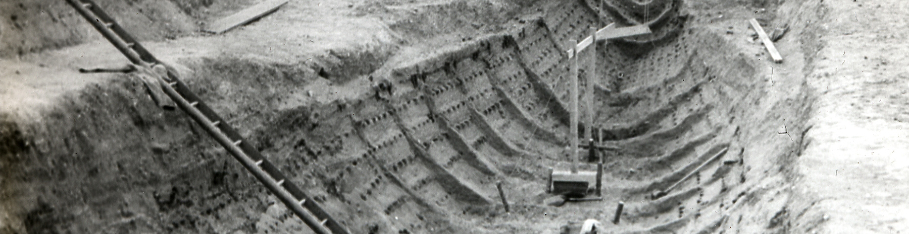 black and white photo of the Sutton Hoo ship burial excavation