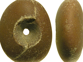showing two sides of a pebble mace, in brown coloured stone with a hole in the middle