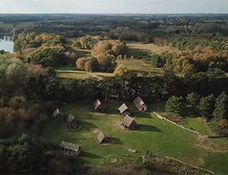 aerial view of west stow anglo-saxon village reconstructed buildings