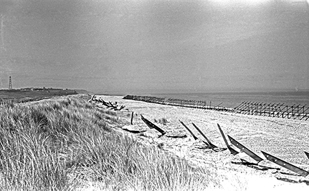 black and white photo of beach scaffolding