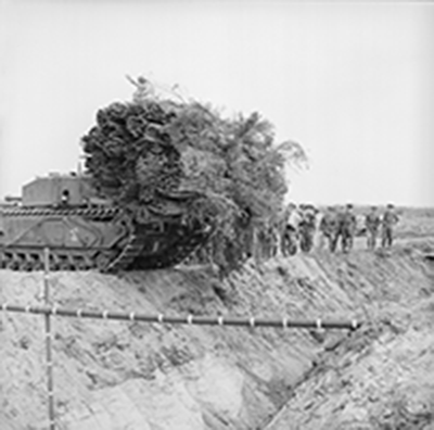war photo of Fascine-carrying tank crossing an anti-tank ditches