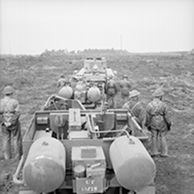 war photo of soldiers with explosives lined up for drills
